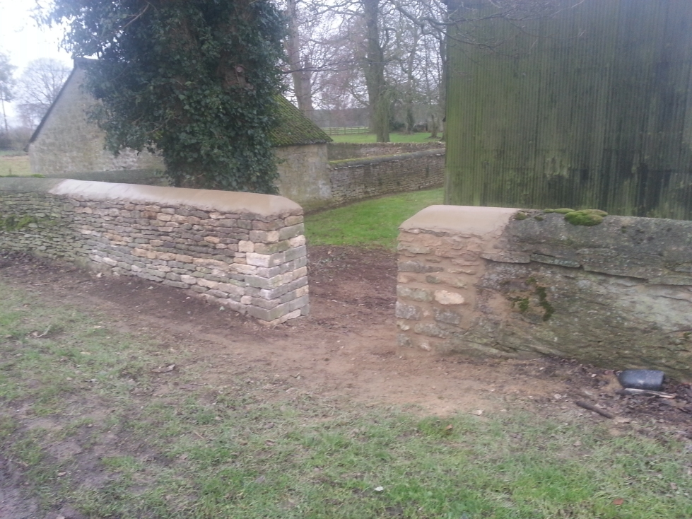 Repaired dry stone wall with cement capping